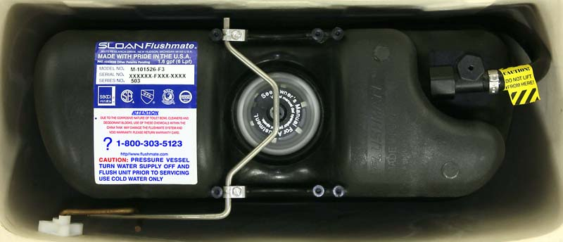 Serial number on top of Flushmate III unit from flushmate.com