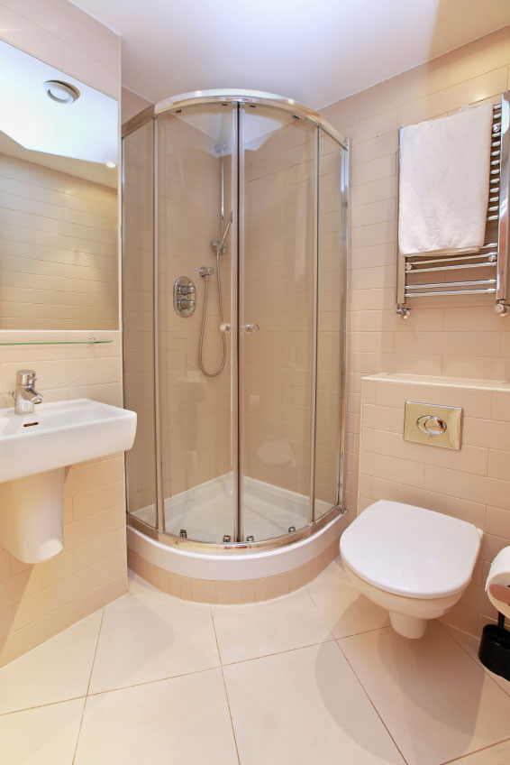 Compact Toilet, Clear Corner Shower, Clean Sink Design